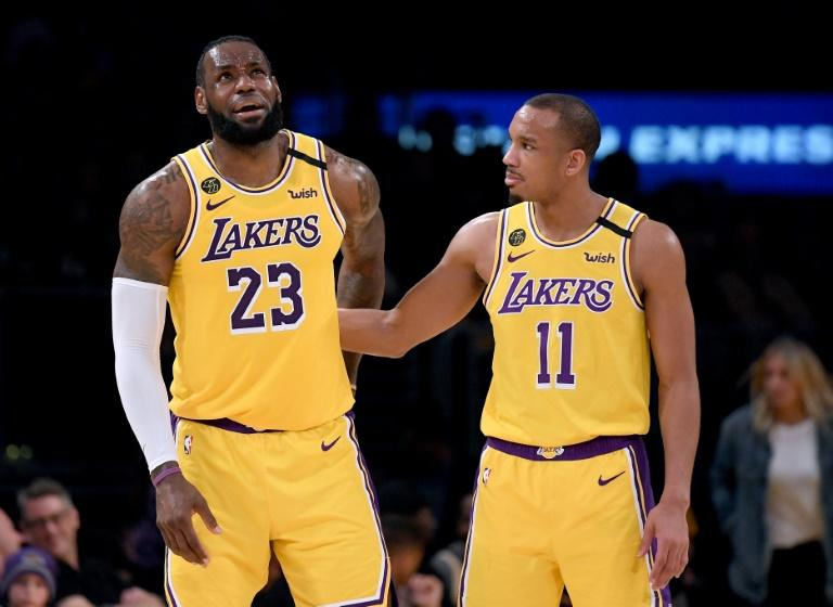 Los Angeles Lakers guard Avery Bradley, at right with star playmaker LeBron James, says he has opted out of playing when the NBA resumes its coronavirus pandemic-halted 2019-20 season next month at Orlando, Florida