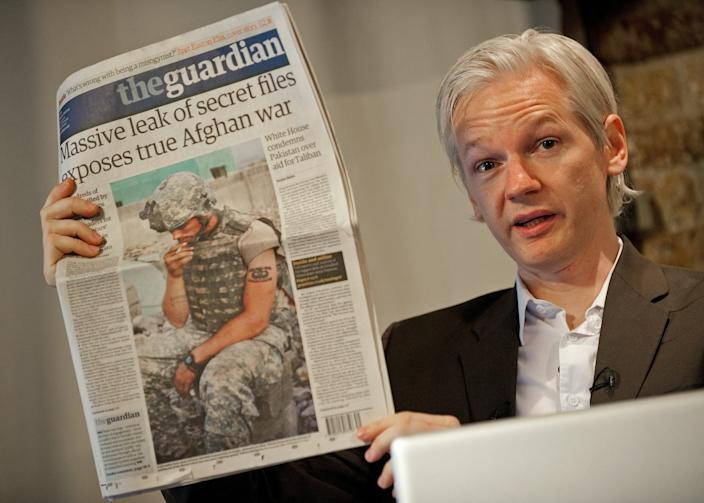 Julian Assange, holds up a copy of today's Guardian newspaper during a press conference in London on July 26, 2010. Assange first rose to prominence after Wikileaks published thousands of leaked military files about the war in Afghanistan In all, some 92,000 documents dating back to 2004 were released by the New York Times, Britain's Guardian newspaper, and Germany's Der Spiegel newsweekly.