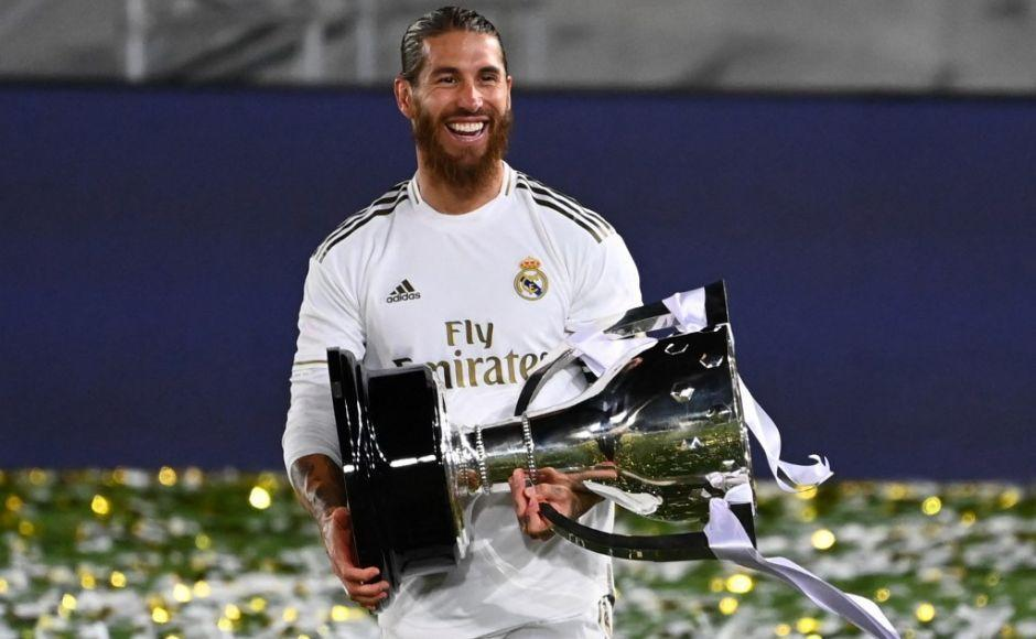(FILES) In this file photo taken on July 16, 2020 Real Madrid's Spanish defender Sergio Ramos celebrates with the trophy after winning the Liga title after the Spanish League football match between Real Madrid CF and Villarreal CF at the Alfredo di Stefano stadium in Valdebebas, on the outskirts of Madrid. - Legendary captain Sergio Ramos is to leave Real Madrid after a glittering, trophy-laden career spanning 671 games and 16 seasons, the club announced on June 16, 2021. (Photo by GABRIEL BOUYS / AFP)