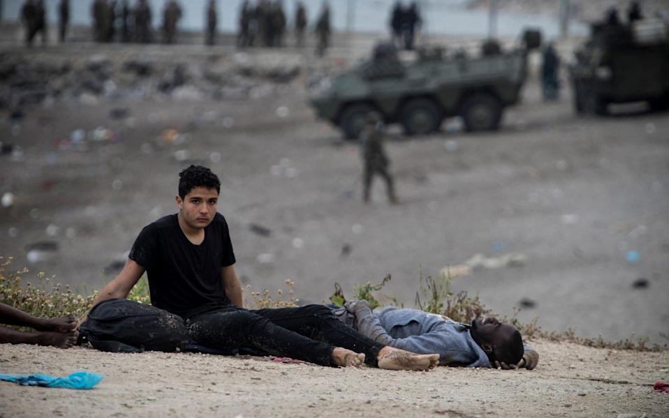 They collapse, exhausted, on the ground afterwards - Javier Fergo/ AP