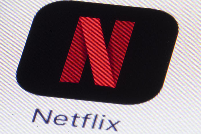 FILE - This Monday, July 17, 2017, file photo shows the Netflix logo on an iPhone in Philadelphia. Streaming services ranging from Netflix to Disney+ want us to stop sharing passwords. That's the new edict from the giants of streaming media, who hope to discourage the common practice of sharing account passwords without alienating their subscribers, who've grown accustomed to the hack. (AP Photo/Matt Rourke, File)