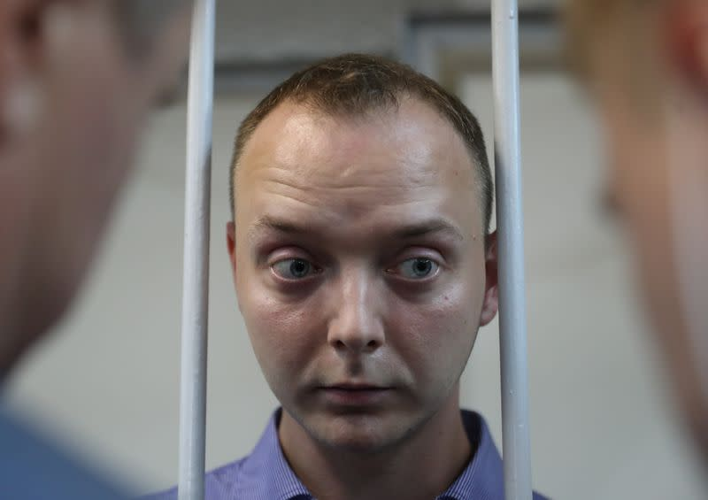 Russia detains ex-journalist accused of passing secrets to West