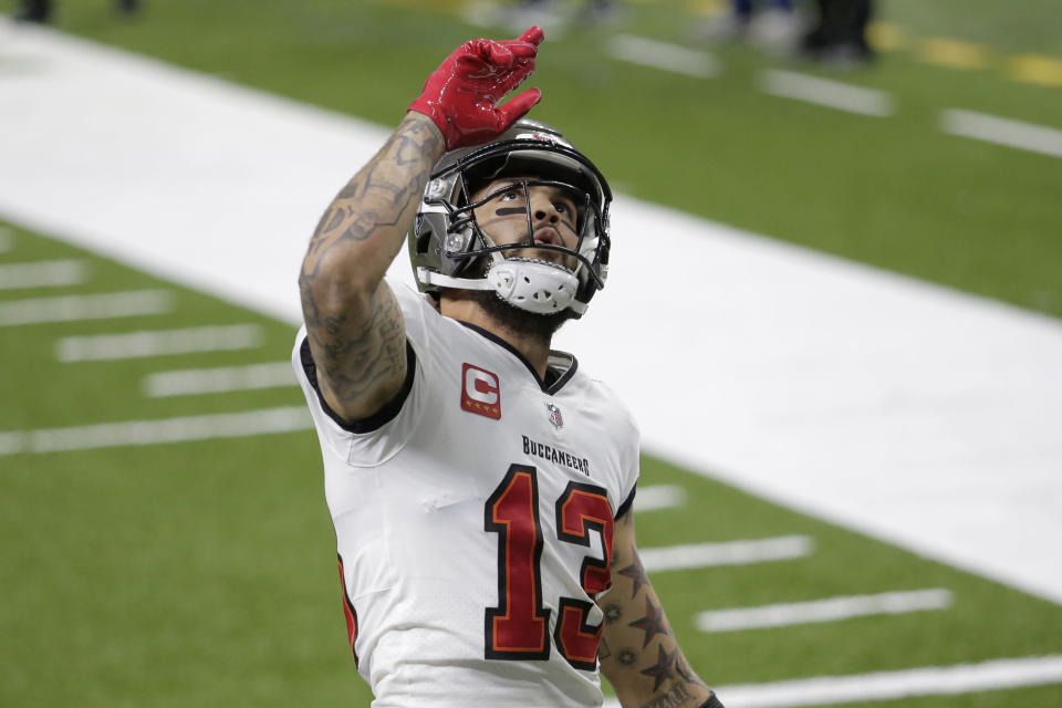 Tampa Bay Buccaneers wide receiver Mike Evans (13) celebrates his touchdown against the New Orleans Saints during the first half of an NFL divisional round playoff football game, Sunday, Jan. 17, 2021, in New Orleans. (AP Photo/Brett Duke)