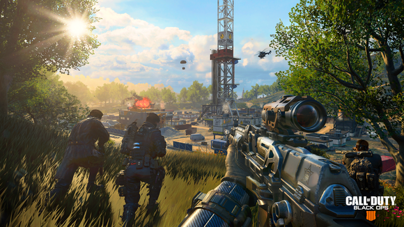 Screenshot of Call of Duty video game depicting the first-person point of view of a soldier running through an open field while holding a sniper rifle.