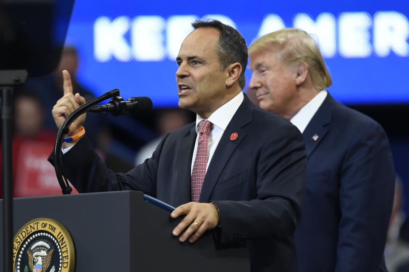 President Donald Trump, right, listens as Kentucky Gov. Matt Bevin, left, speaks during a campaign rally in Lexington, Ky., Monday, Nov. 4, 2019. (AP Photo/Susan Walsh)