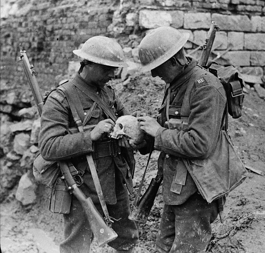 <p>Canadian soldiers inspect a skull they found on the battlefield at Vimy Ridge in April 1917. Photo from CP. </p>
