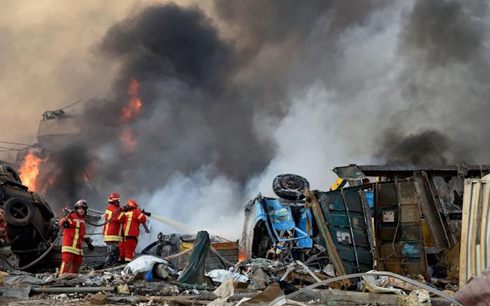 Firefighters tackle the blaze. Many were incinerated by the second blast - WAEL HAMZEH/EPA-EFE/Shutterstock