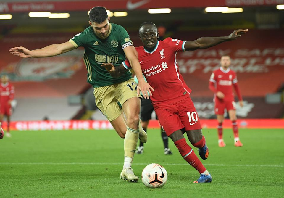 Sheffield United's John Egan (left) in action with Liverpool's Sadio Mane.