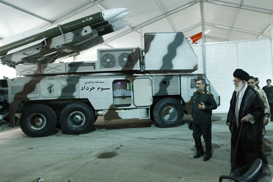 In this photo released on May 11, 2014, by an official website of the office of the Iranian supreme leader, Third of Khordad air defense system is displayed while Supreme Leader Ayatollah Ali Khamenei, right, visits an exhibition of achievements of Revolutionary Guard's aerospace division, Iran. Iran's Revolutionary Guard shot down a U.S. surveillance drone Thursday, June 20, 2019, in the Strait of Hormuz, marking the first time the Islamic Republic directly attacked the American military amid tensions over Tehran's unraveling nuclear deal with world powers. Iran said it has used its air defense system known as Third of Khordad to shoot down the drone — a truck-based missile system that can fire up to 18 miles (30 kilometers) into the sky. Commander of the Revolutionary Guard's aerospace division Gen. Amir Ali Hajizadeh, second right, accompanies Ayatollah Khamenei. (Office of the Iranian Supreme Leader via AP)