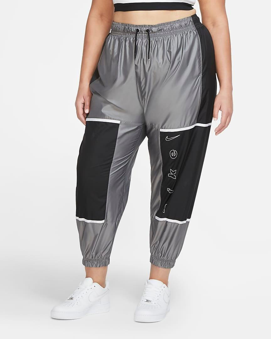 "<br><br><strong>Nike</strong> Woven Pants, $, available at <a href=""https://go.skimresources.com/?id=30283X879131&url=https%3A%2F%2Fwww.nike.com%2Ft%2Fsportswear-womens-woven-pants-V4KjWF%2FCZ6757-010"" rel=""nofollow noopener"" target=""_blank"" data-ylk=""slk:Nike"" class=""link rapid-noclick-resp"">Nike</a>"