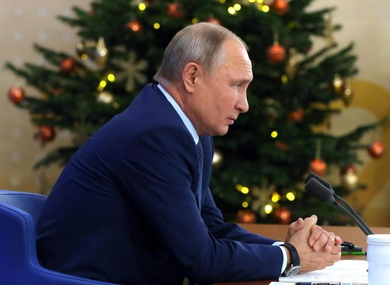 Russian President Vladimir Putin addresses his annual press conference via a video link at the Novo-Ogaryovo state residence outside Moscow.