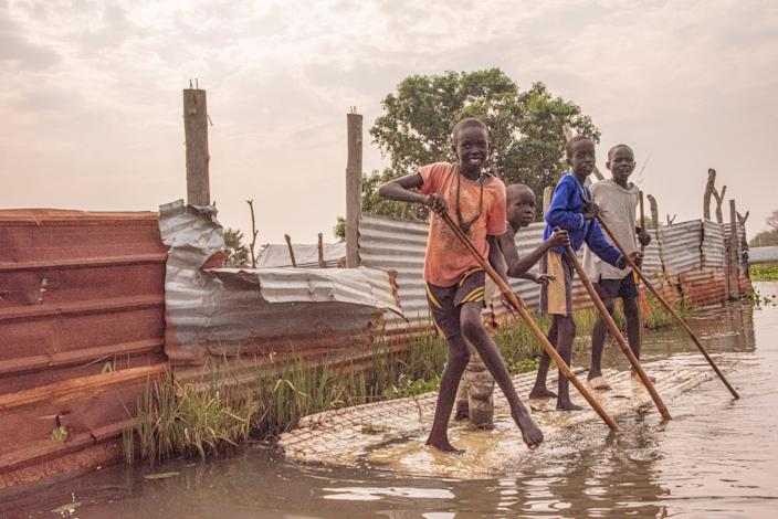 Children in Bor, where regular flooding means locals sometimes resort to canoes to get aroundValentina Morriconi