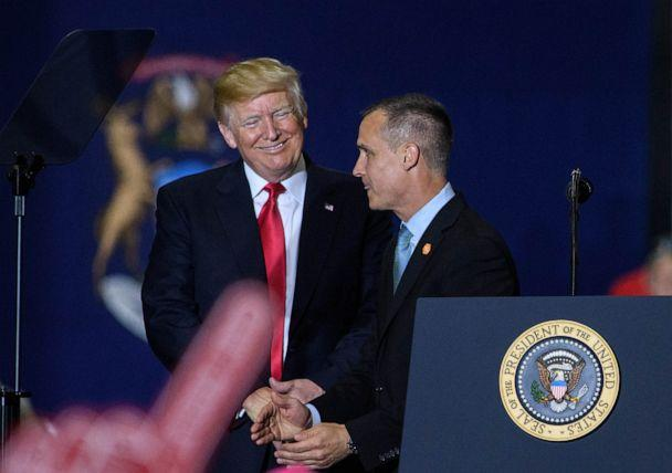 PHOTO: Former Trump Campaign manager Corey Lewandowski speaks as US President Donald Trump looks on during a rally at Total Sports Park in Washington, Michigan on April 28, 2018. (Mandel Ngan/AFP/Getty Images)