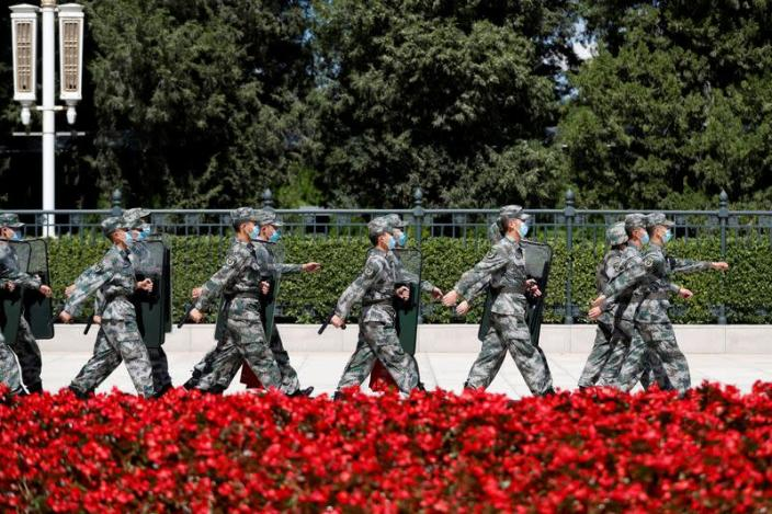 FILE PHOTO: Soldiers of the People's Liberation Army (PLA) march outside the Great Hall of the People in Beijing