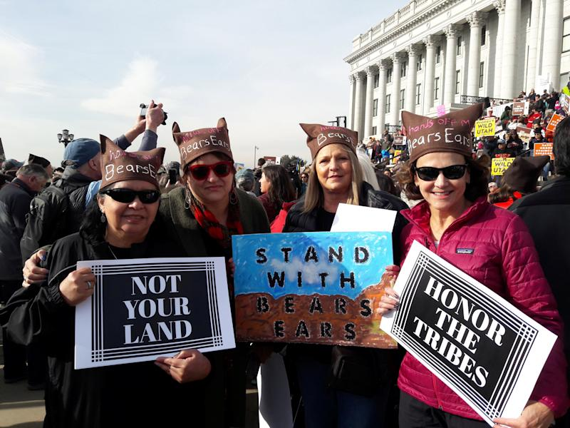 Protesters hold signs during a rally against Trump administration plans to cut the sizes of two national monument areas in the state that are protected from mining and drilling, at the state capitol in Salt Lake City, Utah, U.S. December 2, 2017. Picture taken December 2, 2017. REUTERS/Emily Means