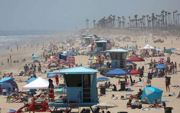 PHOTO: People gather at the beach on July 3, 2020 in Huntington Beach, Calif. (Michael Heiman/Getty Images)