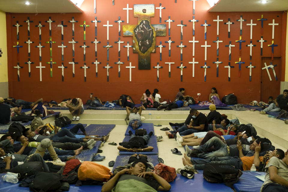 """Central American migrants rest at """"The 72"""" shelter in Tenosique, Tabasco state, Mexico, Tuesday, Feb. 9, 2021. Only six weeks into the year, the shelter has hosted nearly 1,500 migrants compared to 3,000 all of last year, even though it has halved its dormitory capacity due to the new cornavirus pandemic. (AP Photo/Isabel Mateos)"""