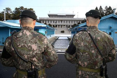 FILE PHOTO - South Korean soldiers stand guard at the truce village of Panmunjom in the demilitarised zone separating the two Koreas, South Korea, January 9, 2018.   REUTERS/Korea Pool