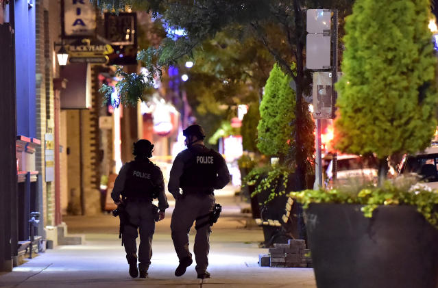 <p>Tactical police officers walk along Danforth Avenue at the scene of a shooting in Toronto on Monday, July 23, 2018. (Photo: Frank Gunn/The Canadian Press via AP) </p>