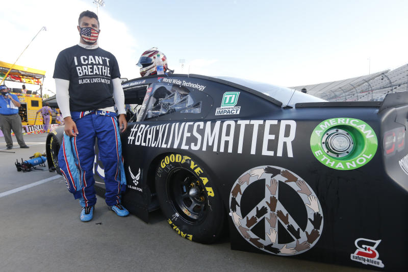 Driver Bubba Wallace waits for the start of a NASCAR Cup Series auto race Wednesday, June 10, 2020, in Martinsville, Va. (AP Photo/Steve Helber)