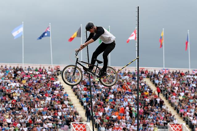 LONDON, ENGLAND - AUGUST 08: An exhibition rider jumps over a stick on Day 12 of the London 2012 Olympic Games at BMX Track on August 8, 2012 in London, England. (Photo by Bryn Lennon/Getty Images)