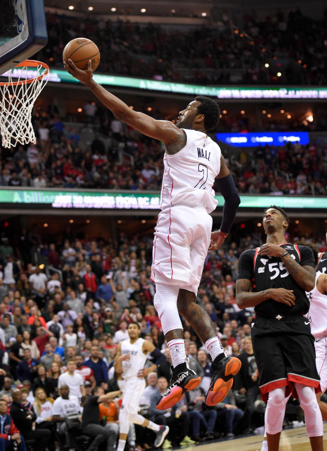 Washington Wizards guard John Wall (2) goes to the basket against Toronto Raptors guard Delon Wright (55) during the second half of Game 4 of an NBA basketball first-round playoff series, Sunday, April 22, 2018, in Washington. (AP Photo/Nick Wass)