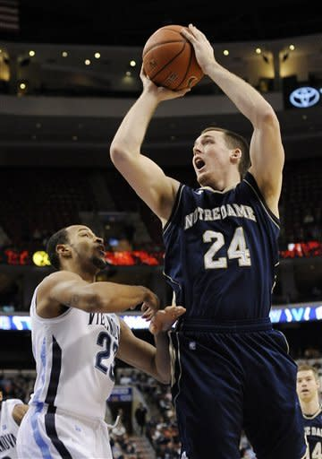 Notre Dame's Pat Connaughton (24) shoots over Villanova's Dominic Cheek (23) in the first half of an NCAA college basketball game on Saturday, Feb. 18, 2012, in Philadelphia. (AP Photo/Michael Perez)