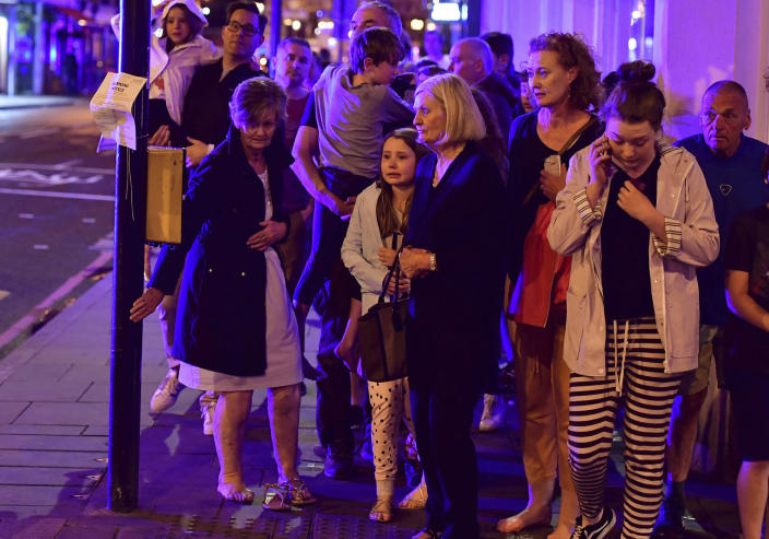 <p>People walking down Borough High Street as police are dealing with an incident on London Bridge in London, Saturday, June 3, 2017. Witnesses reported a vehicle hitting pedestrians and injured people on the ground. (Dominic Lipinski/PA via AP) </p>
