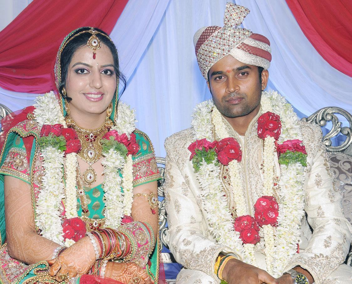 Indian cricketer R Vinay Kumar ties knot to Richa a Delhiitte at a private hotel in Bangalore on Nov.29, 2013. (Photo: IANS)