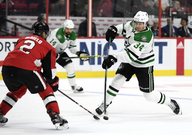 Dallas Stars right wing Denis Gurianov (34) shoots in front of Ottawa Senators defenseman Dylan DeMelo (2) during the second period of an NHL hockey game Sunday, Feb. 16, 2020, in Ottawa, Ontario. (Justin Tang/The Canadian Press via AP)