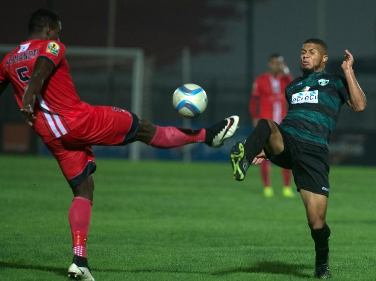 FUS Rabat's Ass Madaw Sy (left) and Mouloudia Bejaia's Morgan Betorangal in action during the CAF Confederation Cup semi-final in Rabat, on September 25, 2016