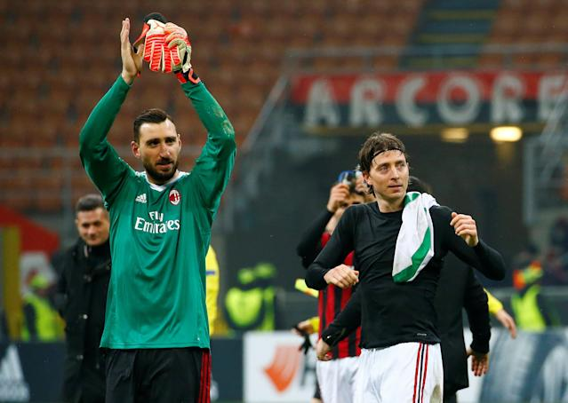 Soccer Football - Europa League Round of 32 Second Leg - AC Milan vs PFC Ludogorets Razgrad - San Siro, Milan, Italy - February 22, 2018 AC Milan's Antonio Donnarumma and Riccardo Montolivo applaud the fans at the end of the match REUTERS/Tony Gentile