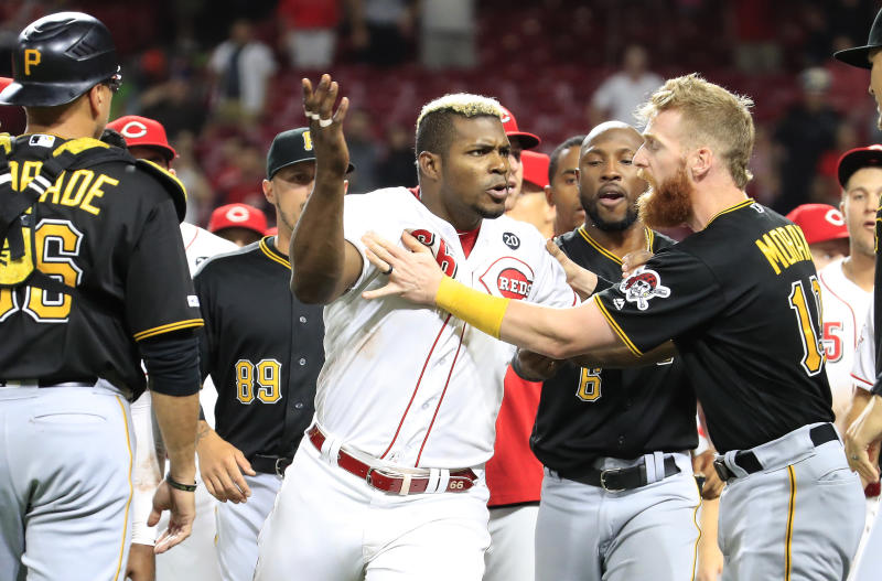 Yasiel Puig's last at as a member of the Reds involved jumping into a brawl against the Pirates after he had been traded. (Getty)