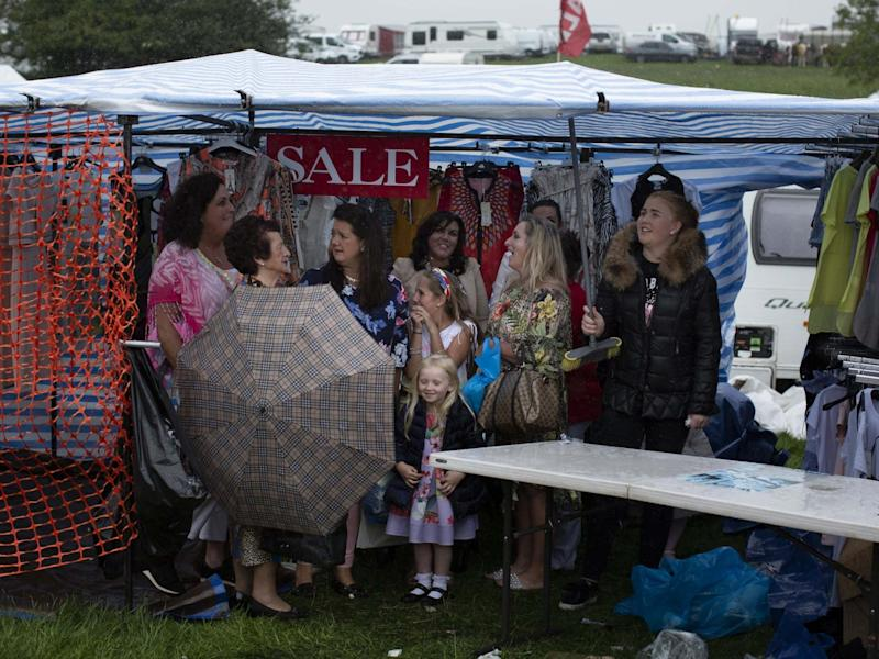 People shelter from the rain during the Appleby Horse Fair. The annual gathering for Gypsy, Romany and Traveller communities dates back to 1685: Getty