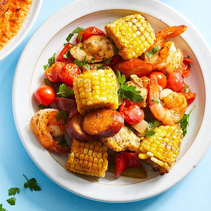 """<p>This variation of a shrimp boil can be made in the oven on just one baking sheet. A medley of spices gives this healthy dish of chicken, sausage and veggies a rich, complex flavor. Bonus: This easy sheet-pan dinner requires just 20 minutes of active prep time.</p> <p> <a href=""""https://www.eatingwell.com/recipe/274849/sheet-pan-creole-chicken-shrimp/"""" rel=""""nofollow noopener"""" target=""""_blank"""" data-ylk=""""slk:View Recipe"""" class=""""link rapid-noclick-resp"""">View Recipe</a></p>"""