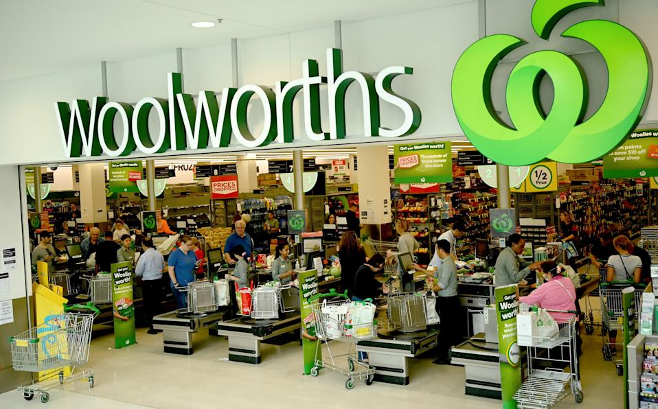 People shop at a Woolworths supermarket in Sydney on March 17, 2020. - Australia's elderly were let in early to supermarkets on March 17, but coronavirus panic buying still proved too much in some areas, with reports of empty shelves and large queues. (Photo by PETER PARKS / AFP) (Photo by PETER PARKS/AFP via Getty Images)
