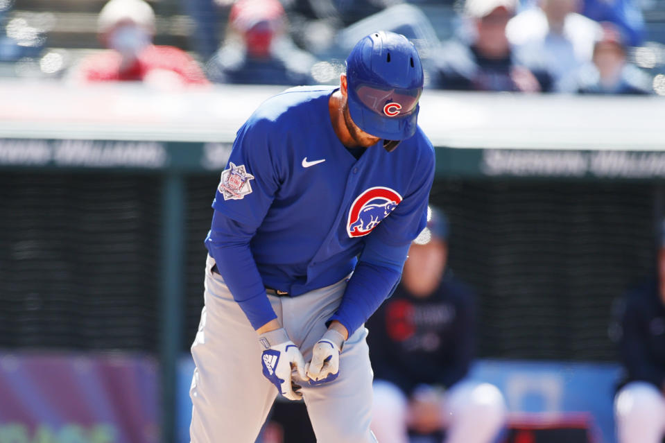 Chicago Cubs' Kris Bryant reacts after being hit by a pitch from Cleveland Indians' Cal Quantrill during the seventh inning of a baseball game, Wednesday, May 12, 2021, in Cleveland. (AP Photo/Ron Schwane)