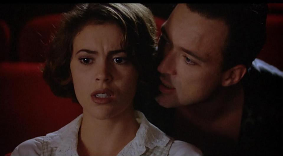 Alyssa Milano looks afraid as Martin Kemp whispers in her ear in Embrace of the Vampire.