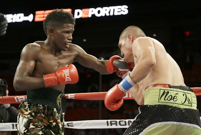 Erickson Lubin, left, fights against Noe Bolanos during a boxing match on July 10, 2014. (AP file photo)