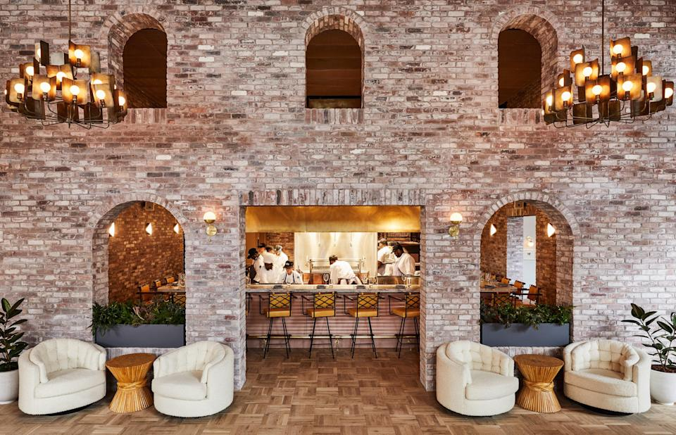 """<p><strong>Set the scene for us.</strong><br> The New York outpost of the rapidly expanding Hoxton brand finds itself in the ever-hip north side of Williamsburg, amid a landscape of converted warehouses and factories (rapidly being torn down for fancy residential buildings) in post-industrial Brooklyn, set in a former water-tower factory with a broad statement staircase sashaying down the middle. Walking through the front doors leads you straight into the restaurant and bar, where guests and curious locals tap away on laptops and gossip. Hunting down check-in is a little less obvious; make a hard left and just keep stopping and asking at whatever desk-seeming corner you find (even if it's a coffee bar).</p> <p><strong>What's the story behind the hotel?</strong><br> This was the first Hoxton in North America. Born in the <a href=""""https://www.cntraveler.com/destinations/london?mbid=synd_yahoo_rss"""" rel=""""nofollow noopener"""" target=""""_blank"""" data-ylk=""""slk:London"""" class=""""link rapid-noclick-resp"""">London</a> district of the same name, outposts already existed in Holborn, as well as <a href=""""https://www.cntraveler.com/destinations/amsterdam?mbid=synd_yahoo_rss"""" rel=""""nofollow noopener"""" target=""""_blank"""" data-ylk=""""slk:Amsterdam"""" class=""""link rapid-noclick-resp"""">Amsterdam</a> and <a href=""""https://www.cntraveler.com/destinations/paris?mbid=synd_yahoo_rss"""" rel=""""nofollow noopener"""" target=""""_blank"""" data-ylk=""""slk:Paris"""" class=""""link rapid-noclick-resp"""">Paris</a>, when this one opened; since then, Hoxtons have sprouted up in Portland, downtown Los Angeles, Chicago, Rome and more. The Soho House Group was involved in the past, and it's easy to see the hand of Nick Jones here: those Art Deco touches, subway-style bathroom tiles and velvet headboards. But there's also local inspiration, such as bespoke linens by Brooklyn-based Dusen Dusen, ceramic pieces, and, in some rooms, books curated by residents (our selection included 'Once Upon a Time in Shaolin: The Untold Story of the Wu-Tang Clan's """