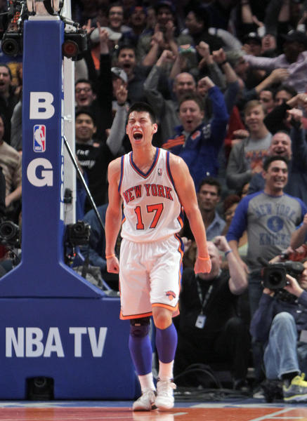 FILE - In this Feb. 19, 2012, file photo, New York Knicks' Jeremy Lin reacts during the second half of an NBA basketball game against the Dallas Mavericks in New York. Linsanity could be put to rest in New York when the clock strikes midnight. That's the deadline the Knicks face to match the daunting offer the Houston Rockets have made to Lin, the Harvard point guard who dazzled all of basketball for a brief stretch last season. (AP Photo/Seth Wenig, File)