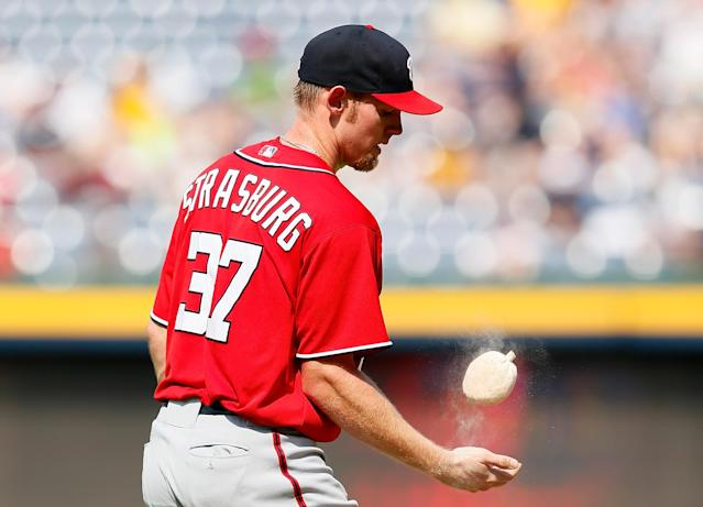 ATLANTA, GA - JUNE 30: Stephen Strasburg #37 of the Washington Nationals tosses some rosin on his right hand in the second inning against the Atlanta Braves at Turner Field on June 30, 2012 in Atlanta, Georgia. (Photo by Kevin C. Cox/Getty Images)
