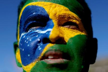 """FILE PHOTO: A demonstrator attends a protest against corruption, in favour of the """"Car Wash"""" corruption investigation and the Brazil's Justice Minister Sergio Moro, in Brasilia"""