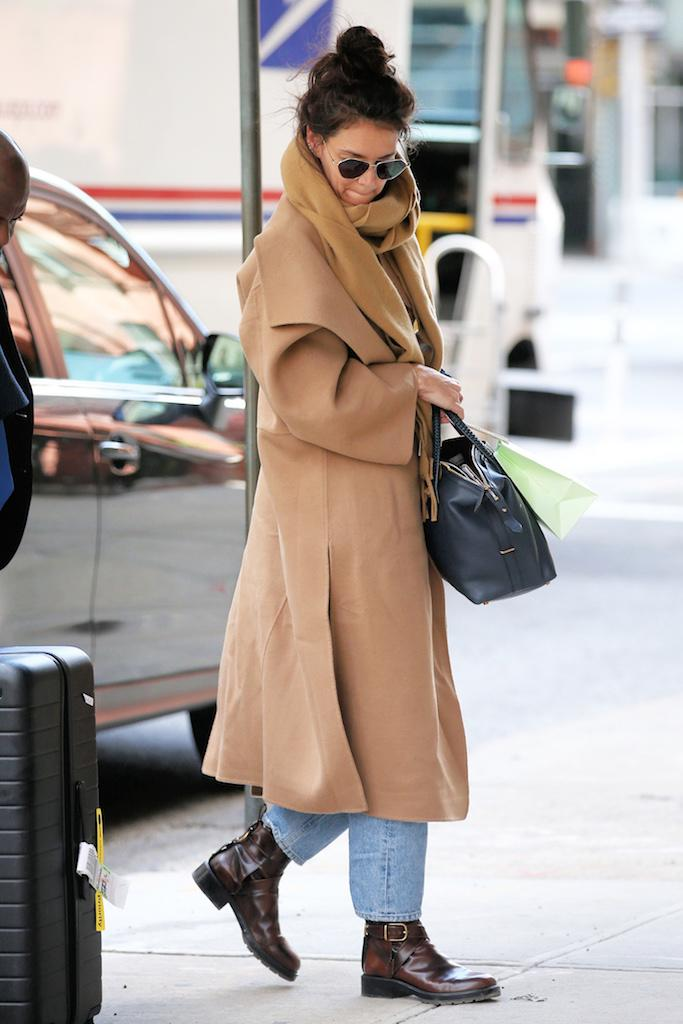 Actress Katie Holmes returns home after attending Paris Fashion Week with a treat of macaroons from Laduree in New York City.Katie is seen in jeans, camel hair coat, buckle boots and long scarf carrying a small hand bag. Pictured: Katie Holmes Ref: SPL5152975 290220 NON-EXCLUSIVE Picture by: Christopher Peterson / SplashNews.com Splash News and Pictures Los Angeles: 310-821-2666 New York: 212-619-2666 London: +44 (0)20 7644 7656 Berlin: +49 175 3764 166 photodesk@splashnews.com World Rights