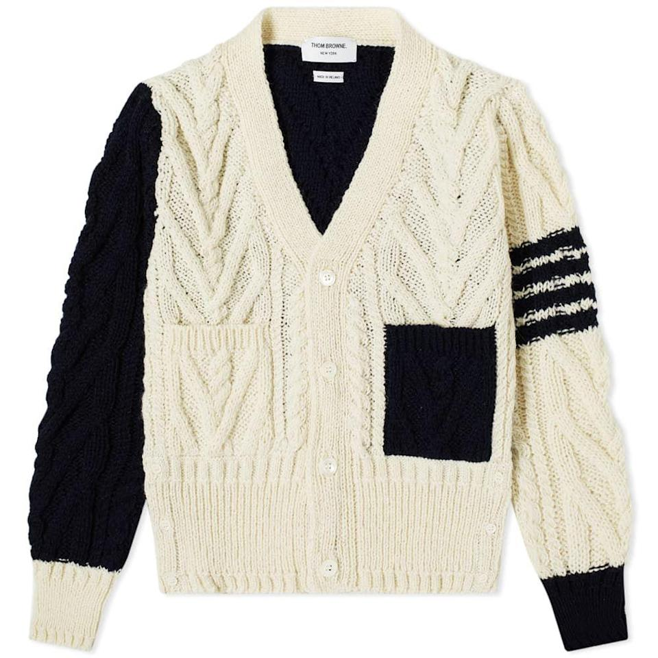 """<p><strong>Thom Browne</strong></p><p>endclothing.com</p><p><strong>$899.00</strong></p><p><a href=""""https://go.redirectingat.com?id=74968X1596630&url=https%3A%2F%2Fwww.endclothing.com%2Fus%2Fthom-browne-4-bar-funmix-aran-cable-knit-cardigan-mkc289f-00278-996.html&sref=https%3A%2F%2Fwww.esquire.com%2Fstyle%2Fmens-fashion%2Fg14012516%2Fcable-knit-sweaters-men%2F"""" rel=""""nofollow noopener"""" target=""""_blank"""" data-ylk=""""slk:Shop Now"""" class=""""link rapid-noclick-resp"""">Shop Now</a></p>"""