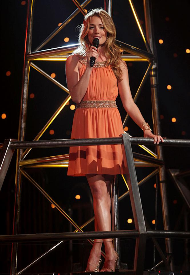 "<a href=""/cat-deeley/contributor/2212390"">Cat Deeley</a> looked lovely in a pale orange Alice + Olivia dress, which she paired with Sergio Rossi heels, Melinda Maria bracelets and vintage Indian earrings, during the Top 16 performances of Season 5 of <a href=""/so-you-think-you-can-dance/show/36160"">""So You Think You Can Dance.""</a>"