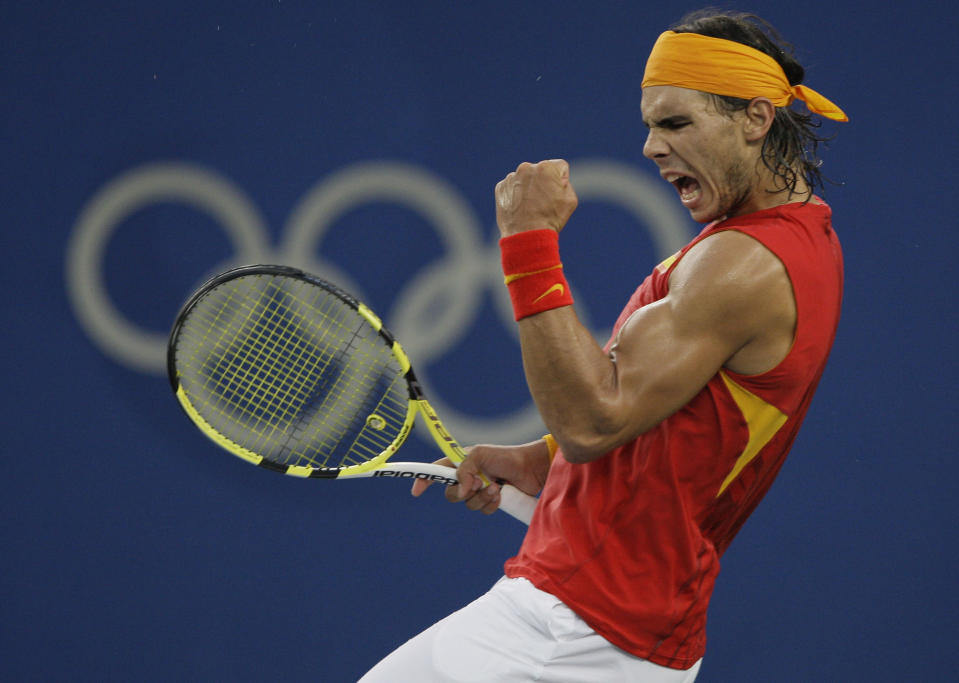 FILE - Rafael Nadal of Spain reacts to winning a point against Fernando Gonzalez of Chile during their Gold medal singles tennis match at the Beijing 2008 Olympics in Beijing, in this Sunday, Aug. 17, 2008, file photo. Nadal will not be participating in the Tokyo Games. (AP Photo/Elise Amendola, File)
