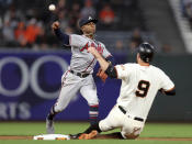 Atlanta Braves shortstop Ozzie Albies (1) forces out San Francisco Giants first baseman Brandon Belt (9) on a Evan Longoria (10) fielder's choice in the first inning of a baseball game in San Francisco, Monday, Sept. 10, 2018. (AP Photo/Scot Tucker)