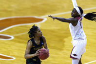 Wright State guard Angel Baker, left, looks to shoot around Arkansas guard Marquesha Davis during the first half of a college basketball game in the first round of the women's NCAA tournament at the Frank Erwin Center in Austin, Texas, Monday, March 22, 2021. (AP Photo/Stephen Spillman)