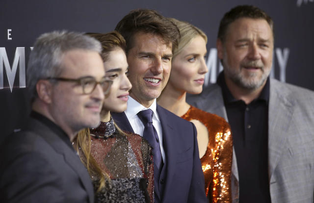 <p>Actors Tom Cruise, center, Russell Crowe, right, Annabelle Wallis, second right, and Sofia Boutella, second left, pose with director Alex Kurtzman, left, as they arrive for the Australian premiere of their movie The Mummy in Sydney, Monday, May 22, 2017. (AP Photo/Rick Rycroft) </p>